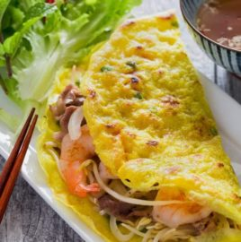 Vietnamese Crepe (Banh Xeo) is thin, crispy and filled with shrimp, and crunchy vegetables
